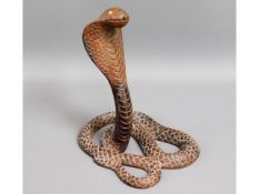 An early 20thC. two piece carved rosewood cobra, 1