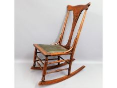 A child's mahogany rocking chair, 34.5in high to t