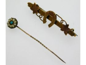 A yellow metal tiepin set with pearl & turquoise t