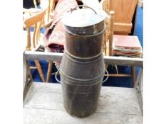 A copper milk churn, dent to front, misshapen to t