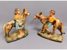 A pair of art deco fireside boy & girl plaster fig