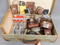 A suitcase of camera boxes including Voigtlander &
