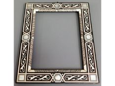 A mother of pearl inlaid Islamic frame, 13in x 7in