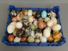 A collection of polished stone eggs, in excess of