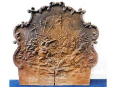 A 16/17thC. cast iron fireback depicting medieval