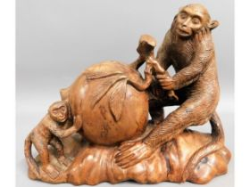 An early 20thC. Chinese carved hardwood monkey & p