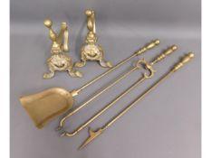 A brass companion & fire dog set