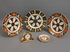 A Royal Crown Derby Old Imari 1128 clock twinned w