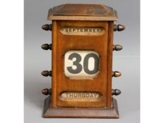 An early 20thC. perpetual calendar, 8.5in tall