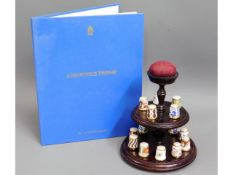 A Royal Crown Derby collection of 15 thimbles with