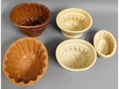 Five Victorian stoneware jelly moulds, three with