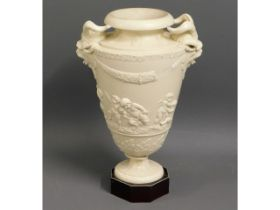 A 19thC. Herculaneum pottery vase, faults to horns
