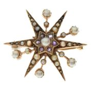 Unmarked yellow metal, seed pearl and red stones star brooch, 4cm diameter, 7.3g gross approx