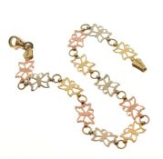 Yellow metal bracelet of three-colour design and linked butterfly motifs, stamped 10k, 18.5cm