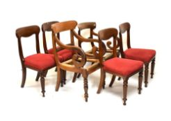 Four Victorian mahogany buckle-back dining chairs with over-stuffed seats, together with a Regency