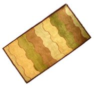 Modern wool rug with abstract meander design in earth colours, 162cm x 246cm Condition: Loss to