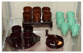 Three sets of Bakelite egg cups, together with a patent Patons & Baldwins 'patwin' rug wool cutter