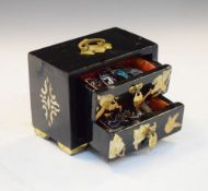 Oriental black lacquer jewellery chest containing a selection of white metal and enamel brooches,