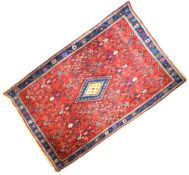 Middle Eastern wool rug, probably North West Persia, the bright red field with all-over boteh, 160cm