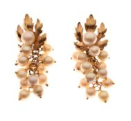 Pair of unmarked yellow metal and cultured pearl ear studs of leaf design, the pearl drops formed as