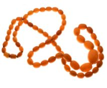 Graduated string of amber beads, 84cm long approx, 52g approx Condition: **Due to current lockdown