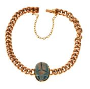 Yellow metal curb link bracelet with 'scarab beetle', clasp stamped 15ct, 12.4g gross approx