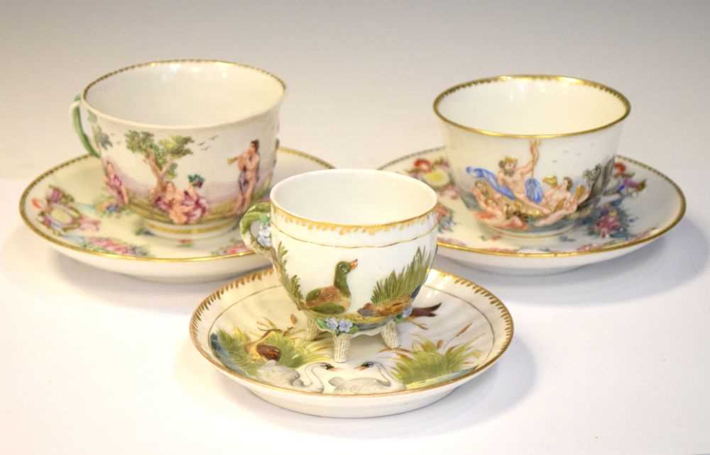 Three Capodimonte cups and saucers