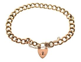 Yellow metal curb-link charm bracelet with 9ct gold padlock