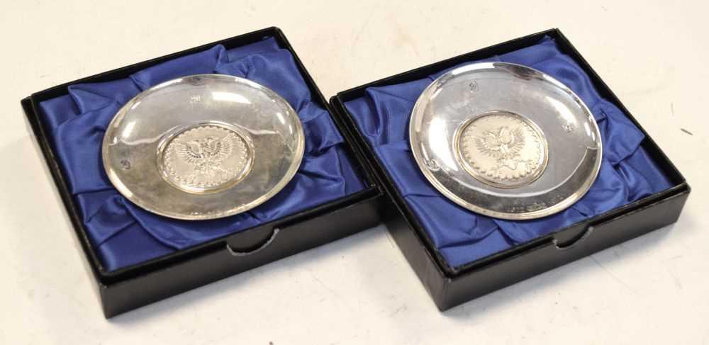 Pair of Elizabeth II Britannia standard silver pin dishes commemorating the 300th anniversary
