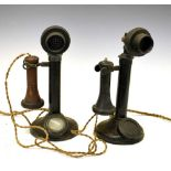 Two 'candlestick' telephones