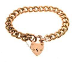 Yellow metal curb-link charm bracelet