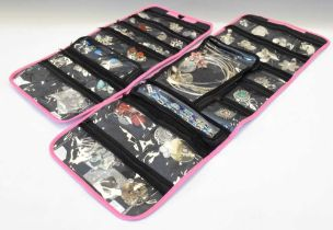 Two pink cloth pouches containing assorted silver, white metal and other jewellery