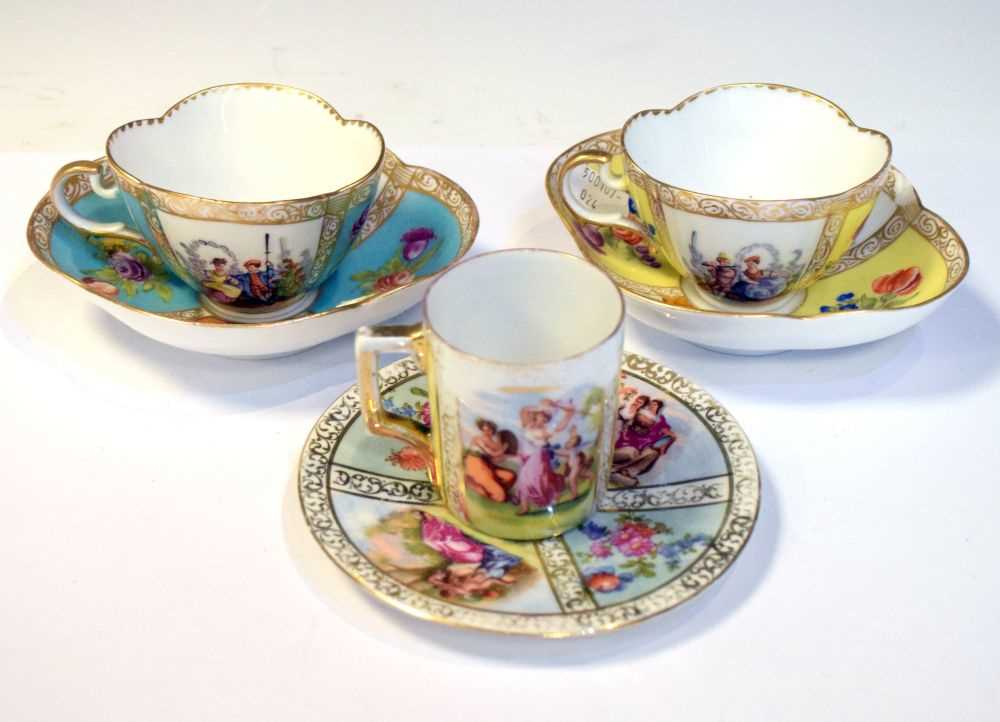 Two Dresden cups and saucers and Vienna style can and saucer