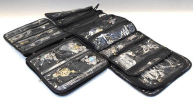Two black cloth pouches containing assorted silver and white metal jewellery