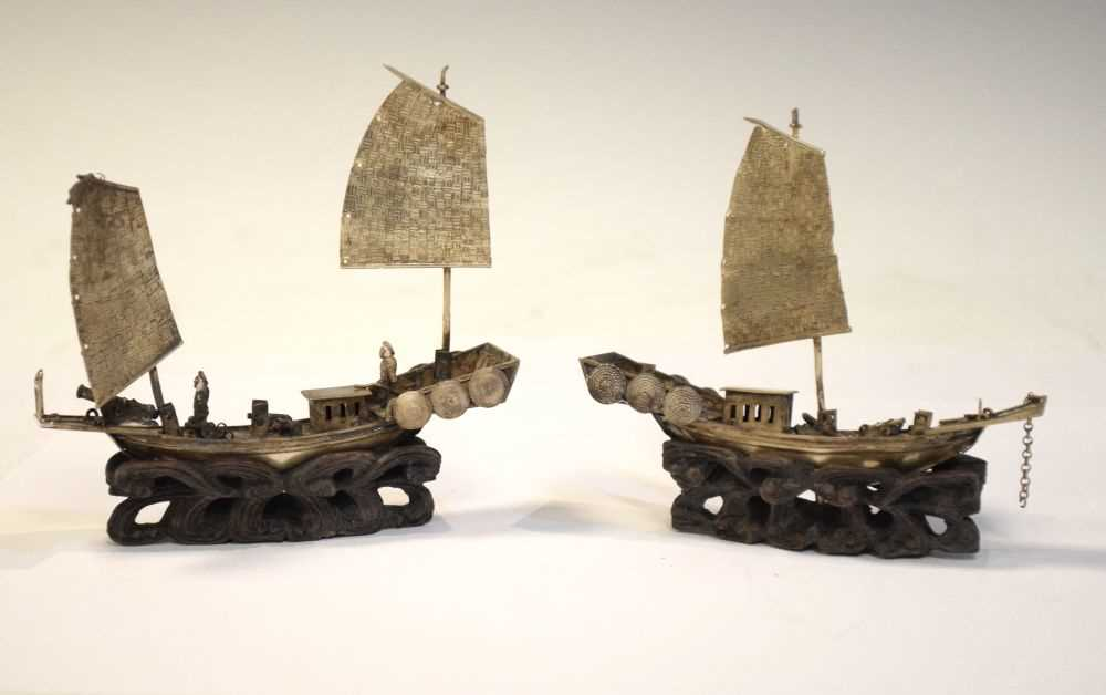 Two Chinese white metal models of junks,