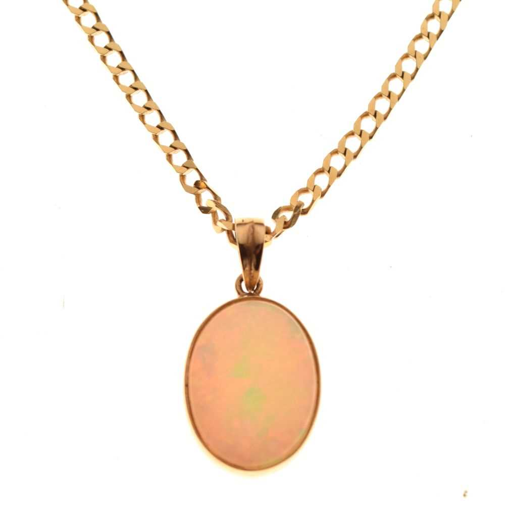 Yellow metal and opal pendant