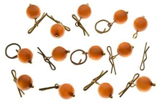 Collection of thirteen amber bead buttons,