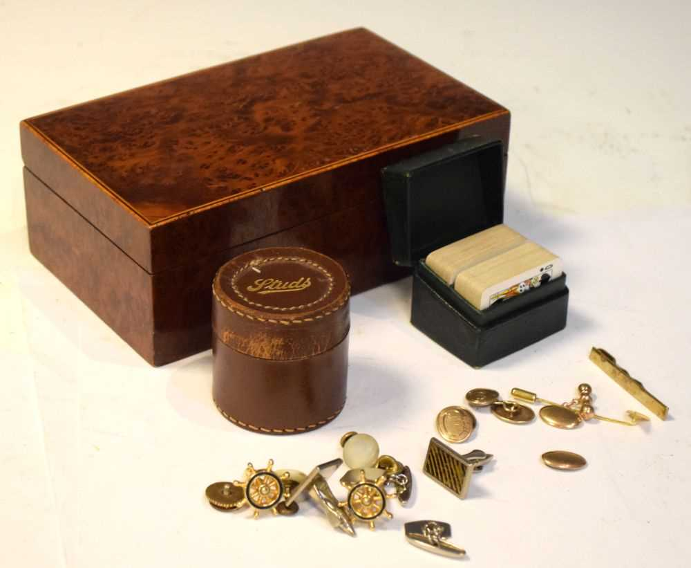 Two pairs gold plated cufflinks, etc in a table top box