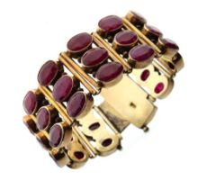 Silver-gilt bracelet of three rows of oval faceted rubies