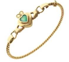 Unmarked yellow metal Claddagh bangle