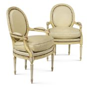 """A pair of armchairs in lacquered wood """"Louis XVI"""" France, beginning of the 20th century h. 93 cm."""