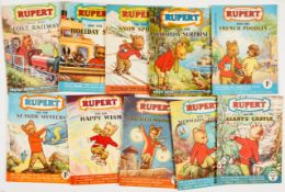"Rupert Adventure Series (D. Express 1950s) 21-30. Bright covers, white pages. No 21: 2 x ½"" piece"