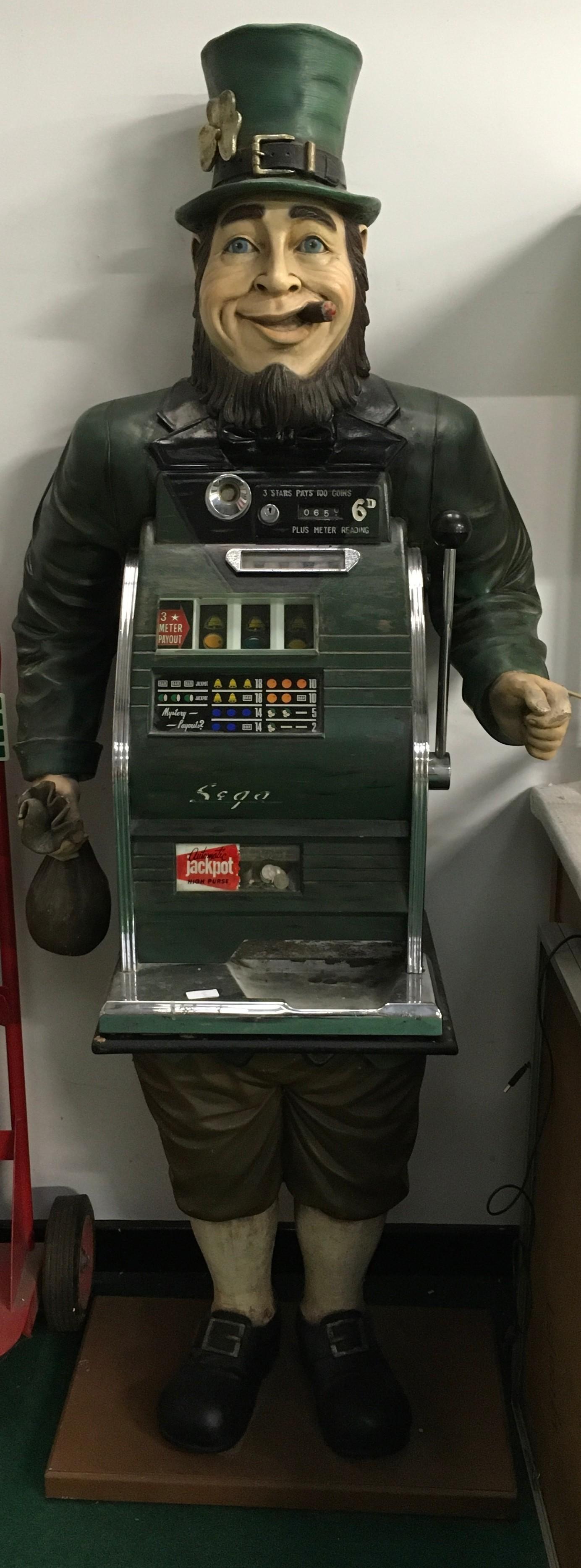 Sega Slot Machine. Set in full size Leprechaun. Works on 6d coin.