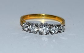 Gold on silver 5 stone CZ ring. Size O.