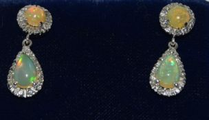 Pair 18ct white gold Fiery opal drop earrings with some diamond surrounds, drop 2.5cm ,1cm round