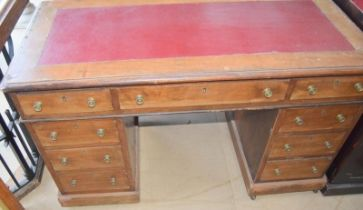 Mahogany leather top pedestal desk 4 draws per side with central draw having brass handles