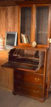 Mahogany secretaire bookcase, of 2 parts with brass handles,and glassed upper part, fitted