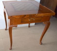 Mahogany games table with lift out center for other games and usage standing on cabriole legs with