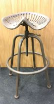 A heavy tractor stool. (ref 176)