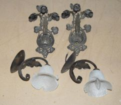 Two pairs of ornate wall light fittings